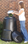 A thumbnail of a women emptying a silver kitchen caddy into a black 330 litre Straight composter