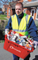 A thumnail of a council employee emtying a kerbside box filled with plastic bottles