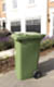 Thumbnail of a green 240 wheeled bin in situ