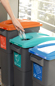 Thumbnail image of three recycling bins next to each other in an office