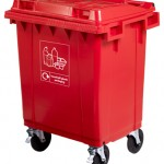 A red four wheeled bin with custom labelling