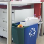 A blue deskside bin with two recycling trays