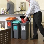 Three bins for different recycling options in a communal area