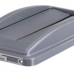 A lid with two swing slots in grey