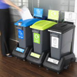 Three differents EcoSort recycling bins next to each other placed in trolles.