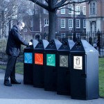 A line of black hexagonal bins in use