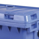 A close up of a blue four wheeled bins hinge and handle