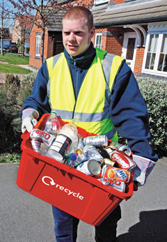A man in a collecting kerbside recycling
