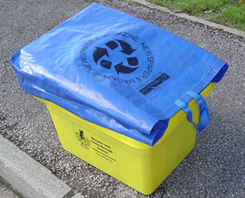 A blue lid bag acting as a lid for a yellow box