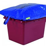 A blue lid bag on a purple kerbside box