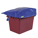 A blue bag placed on top of a kerside box