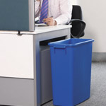 A blue bin next to a desk