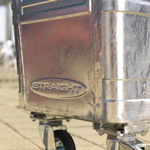 A close up on a base of a silver four wheeled bin with a Straight logo on it