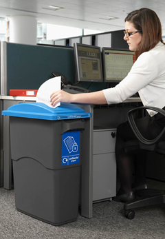 A female employee adding paper to a securely locked bin