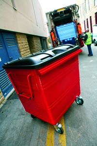 A four wheeled bin, next in line to be emtied by a binman