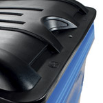 A close up of a black lid on a four wheeled bin
