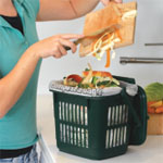Food being scrapped into a vented kitchen caddy
