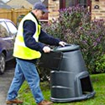 A delivery driver arriving at a domestic address  with a customer's order