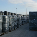 Stacked waterbutts and composters in our outside storage at Hull