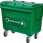 A large green four wheeled bin with 'food waste' written on the front