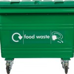A front on shot of a green four wheeled bin on a white background