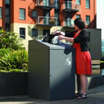 A wheelie bin housing that allows users to deposit waste material
