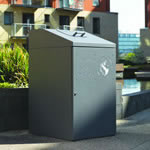 Wheelie bin housing shown outside at a communal area