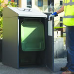 A  wheelie bin housing with its front door open