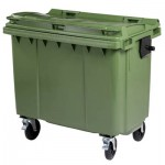 A green four wheeled bin on a white background