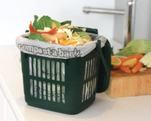 Vented Kitchen Caddy on a kitchen counter with vegetable pealings