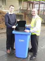 Coucil employees demonstrating how the inner caddies work with a two wheeled bin