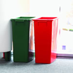 A red and green bin next to each other