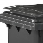 A close up of a black two wheeled bin