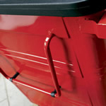 Large handles on the side of a red four wheeled bin