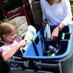 A large blue caddy in use by a mother and child
