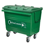 A green four wheeled bin