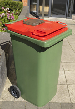 A wheelie bin with a modified lid with a small hatch for food waste