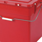 A carry handle on the side of a red hazardous waste box