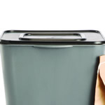 The top of a kitchen composter with a lid