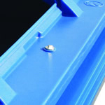 A locking mechanism on a blue four wheeled bin designed to stop the lid benig opened
