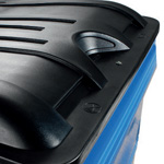 A close up of a black lid on a blue four wheeled bin