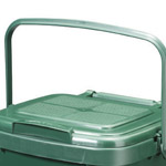 A green kitchen caddy with a perforated lid