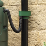 A green Rain Trap rain diverter connecting a downpipe to a water butt
