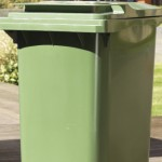 A two wheeled bin outside a property waiting for collection