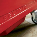 The base of a red four wheeled bin