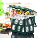 A green vented kitchen caddy