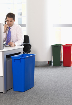 A blue color coded bin in an office