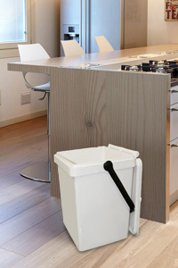 A white EcoCaddy in a Kitchen with its lid open