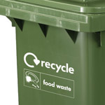 A recycle and food waste logo stamped onto the front of a bin